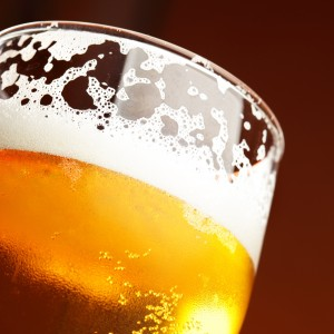 Close up of beer glass with froth